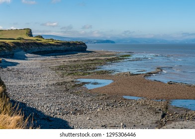 Kilve Beach in Somerset, England, UK - looking over the Bristol Channel with Watchet and Minehead in the background