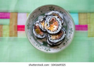 Kimbap filled with kimchi, vegetables, egg
