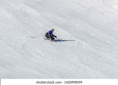 KIMBERLEY, CANADA - MARCH 22, 2019: handicapped person riding a sit-skis Vancouver Adaptive Snow Sports.