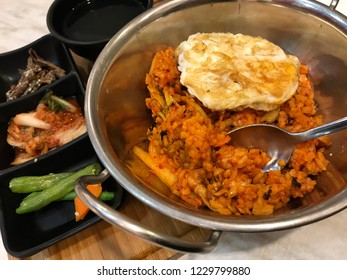 Kimchi fried rice or kimchi-bokkeum-bap is a variety of bokkeum-bap, a popular dish in Korea. Kimchi fried rice is made primarily with kimchi and rice.