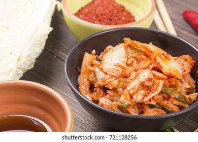 Kimchi korean pickled napa cabbage on black plate
