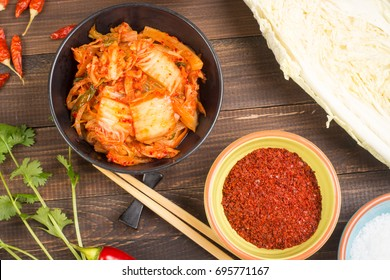 Kimchi - Korean superfood. Pickled chinese cabbage in bowl on wooden table
