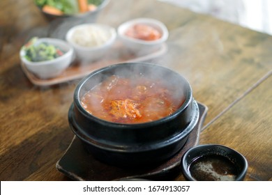Kimchi Soup with tofu and pork belly served in clay pot, One of the most loved of all the stews in Korean cuisine, Most popular food in Korea.