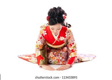 ?apanese kimono woman bowing on white background