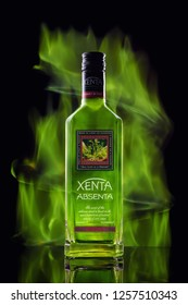 KIMRY,RUSSIA,13 October 2018: Bottle with absinthe against the background of green fire Stock Photo. Absinthe. ABSENTA Xenta against the background of the northern lights.