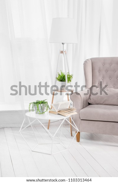 Kind of empty room, table and book, armchair