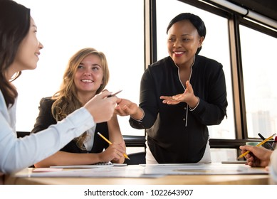 Kind and friendly black businesswoman leader supporting her colleague in the meeting