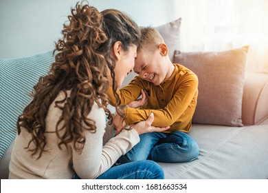 The kind of love that can't be described, only felt. Mother and her child, tickling, kidding and having fun in the couch, with spontaneous smiles. Loving my son