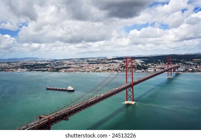 Kind on the river Tagus and the bridge of a name on April, 25, Lisbon, Portugal