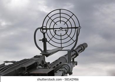 Kind on the sky through a machine gun sight
