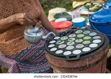 kind of Thai sweetmeat . Coconut milk mix with powder fried dessert. Making of Thai sweetmeat khanomkhrok. Local Thai food, Kind of thai sweetmeat, coconut pudding, sweetmeat. kind, dessert.