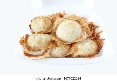 kind of Thai sweetmeat in a foam dish with clipping path on white background. Kanom Krok, Thai traditional dessert. Coconut milk mix with powder fried dessert. Local Thai food