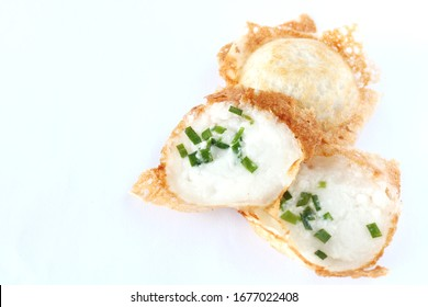 kind of Thai sweetmeat on white background. Kanom Krok, Thai traditional dessert. Coconut milk mix with powder fried dessert. Local Thai food