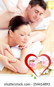 Kind young couple receiving a back massage against heart