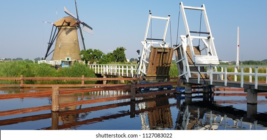 KINDERDIJK, HOLLAND IN 15 JUNE 2018: The Kinderdijk windmills are a group of 19 windmills protected by the Unesco World Heritage since 1997