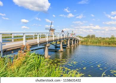 Kinderdijk, Netherlands - August 17, 2018: Bridge To Cross The Canal At Kinderdijk