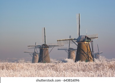KINDERDIJK, THE NETHERLANDS, EUROPE - JANUARY 15, 2011: Dutch historic windmills in a frozen landscape.