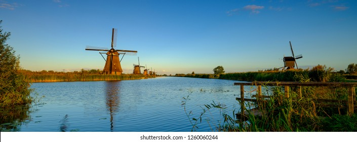 Kinderdijk, Netherlands - Sep 29 2018: Colourful twilight on the UNESCO Historical site of Kinderdijk Windmills