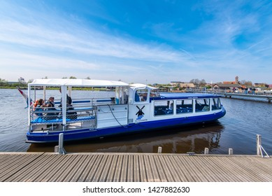 KINDERDIJK, SOUTH HOLLAND, NETHERLANDS - 16APR2019:  The Prins Friso Canal Hopper takes tourists to various points in the Kinderdijk UNESCO World Heritage site.