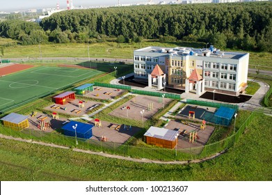 kindergarten building with playing and sports area