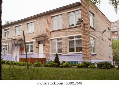 The kindergarten building in Russia, the brick two-storeyed house.