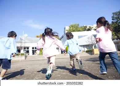 kindergarten children running in the playground