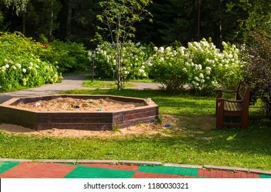 kindergarten, children's Playground in the Park, children's sandbox is located opposite the bench