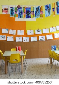 kindergarten class with the yellow chairs and children's drawings