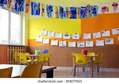 kindergarten class with the yellow chairs and many children's drawings on the walls