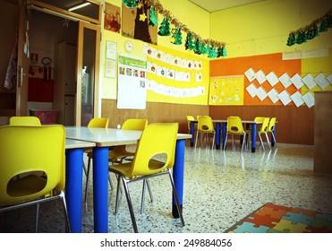 kindergarten classroom with yellow chairs