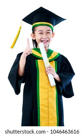Kindergarten graduation. Asian child in graduation gown holding diploma certificate and showing forefinger up sign at studio. Cute girl gets good idea and smiling happily. Isolated on white background