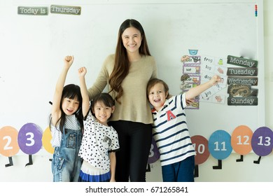 kindergarten kids and teacher
