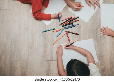 Kindergarten and preschool Kids and teacher drawing,painting on paper learning colorful education top view with copy space.