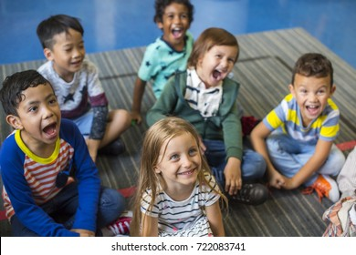 Kindergarten students sitting on the floor