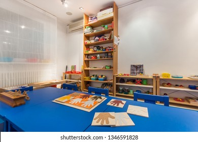 Kindergarten tables with a lot of object. Preschool classroom interior