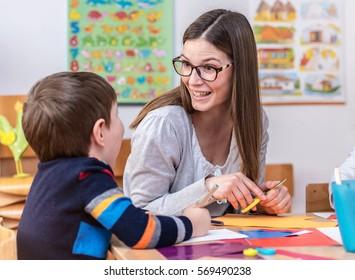Kindergarten Teacher Surprised by Something Child Did