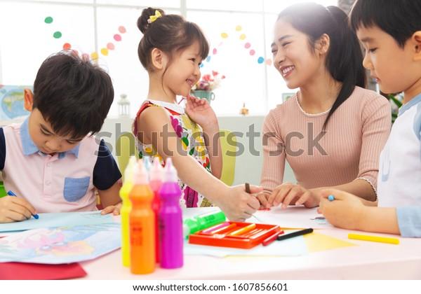 Kindergarten teachers and the children