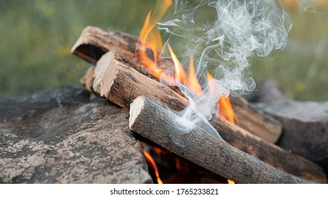 Kindling a fire of wood for cooking barbecue in nature. High quality photo