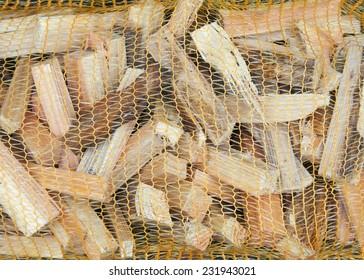 Kindling wood in mesh bag background