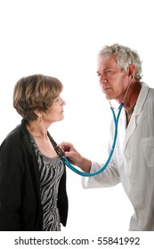 a kindly doctor checks his patient for a heartbeat