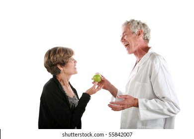 a kindly doctor prescribes an apple to his patient daily