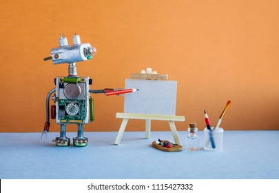Kindly robot artist begins to create a drawing with a pencil. White paper template, wooden easel and artist's tools palette, pencils case. Advertising poster studio school of visual arts interior