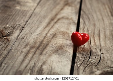 kindness concept, kind actions, sharing love and compassion, red heart on wooden background