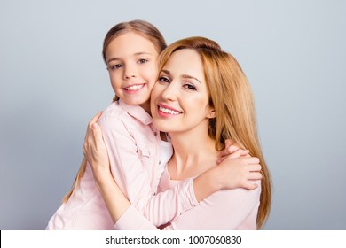 Kindness help growing-up baby offspring age development person warmth mama mommy concept. Close up portrait of cheerful excited glad beautiful mom and cute sweet lovely kid isolated on gray background