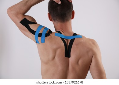 Kinesiology taping. Back pain, Sport man exercising injury. Alternative medicine concept