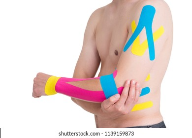 Kinesiology taping on human hand, isolated on white background