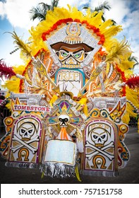 "King of the Bands leads a troop of numerous dancers in Junkanoo"" a Caribbean parade held ."
