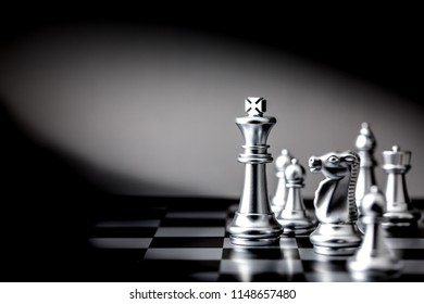 The King in battle chess board game concept of business leader for market target strategy.