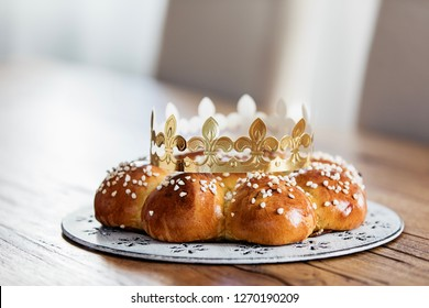 King Bread, called in German language Dreikönigskuchen, baked in Switzerland on January 6th. Small plastic miniature of the king is hidden inside of the bread. The person who finds it, is the king.