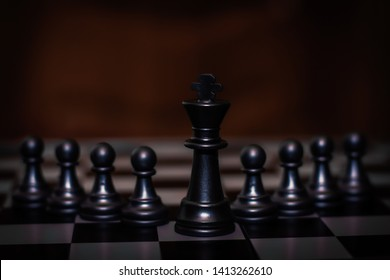 King chess piece stand in front of pawn (Concept of leadership, management)